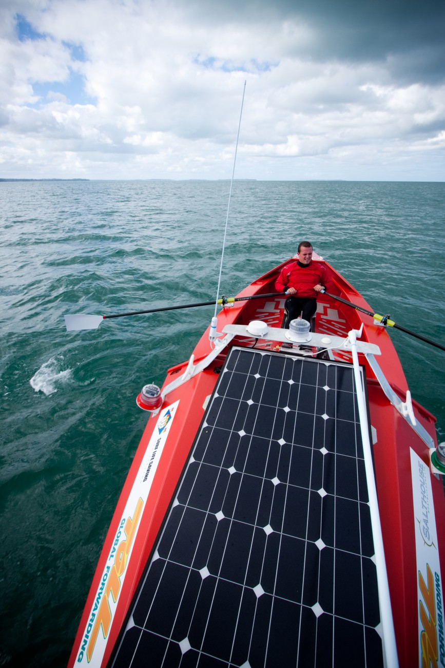 A large solar panel on the cabin top of Tasman Trespasser II can provide six amps of charge for strobes, VHF and navigation equipment. The boat, however, can only be powered by elbow grease. Quincey consumes 9000 food calories a day to keep up with the effort, and lost six kilograms of body weight in the first 22 days.