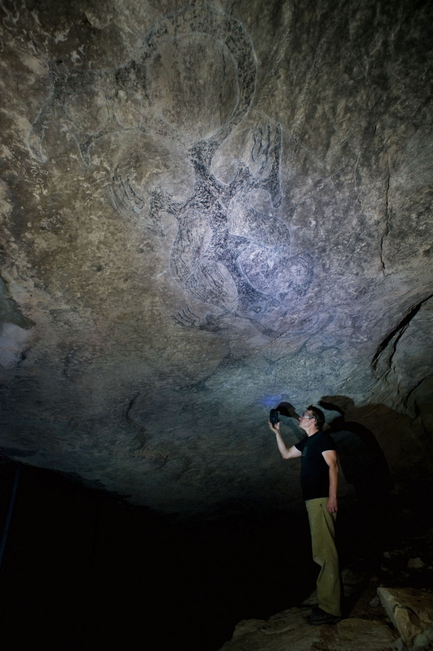 "French anthropologist and rock art expert Dr Yann-Pierre Montelle (opposite)uses UV light to identify layers of pigment at the Opihi taniwha site in South Canterbury. ""This,"" he says, ""is the Lascaux of New Zealand."""
