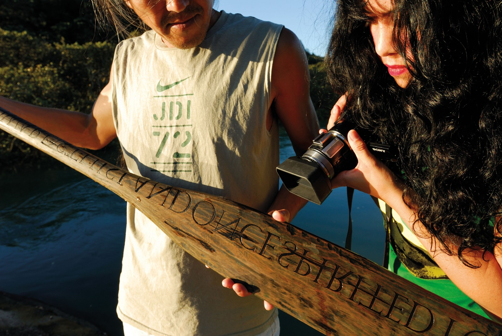 A special connection between land and sea is not lost on artist Kazu Nakagawa as he gives an old Waiheke oar a new lease of life in an artwork. Carved with the words TOWARDS THIS LAND ONCE SPIRITED—alluding to the paddle's history—the work serves here as a prop for filmmaker Bridget Quick. Her short film-in-progress, Knowing, traces Nakagawa's journey from marine engineer in Tokyo to Waiheke-based artist.