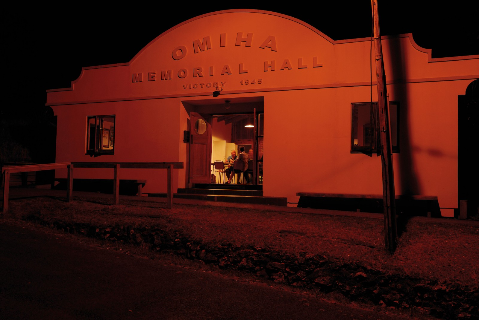 Light spills from an open doorway at a meeting of the Omiha Welfare and Recreation Society. Built in the 1930s, the Omiha Memorial Hall is the hub of social life in Rocky Bay, a relatively isolated community on the island's southern coast. This art deco façade was constructed a few years ago and tacked onto the existing structure, finalising plans that were drafted in the 1950s.