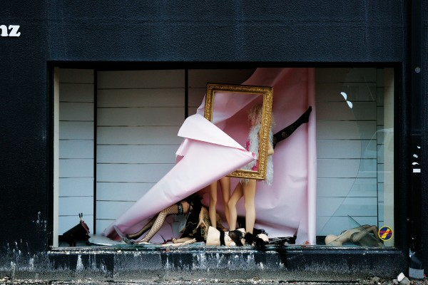 One wild night—contorted mannequin limbs are strewn around an inner city shop window display.