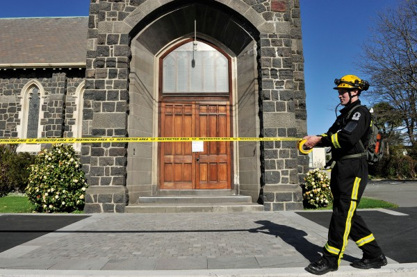 The NZ Fire Service, assigned to Civil Defence operations, cordons off the damaged St Mary's Anglican church in Merivale.