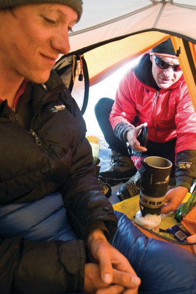 Modern tents are a reliable sanctuary from the storms and high winds of the alpine environment. And nothing beats a hot brew after a long climb.