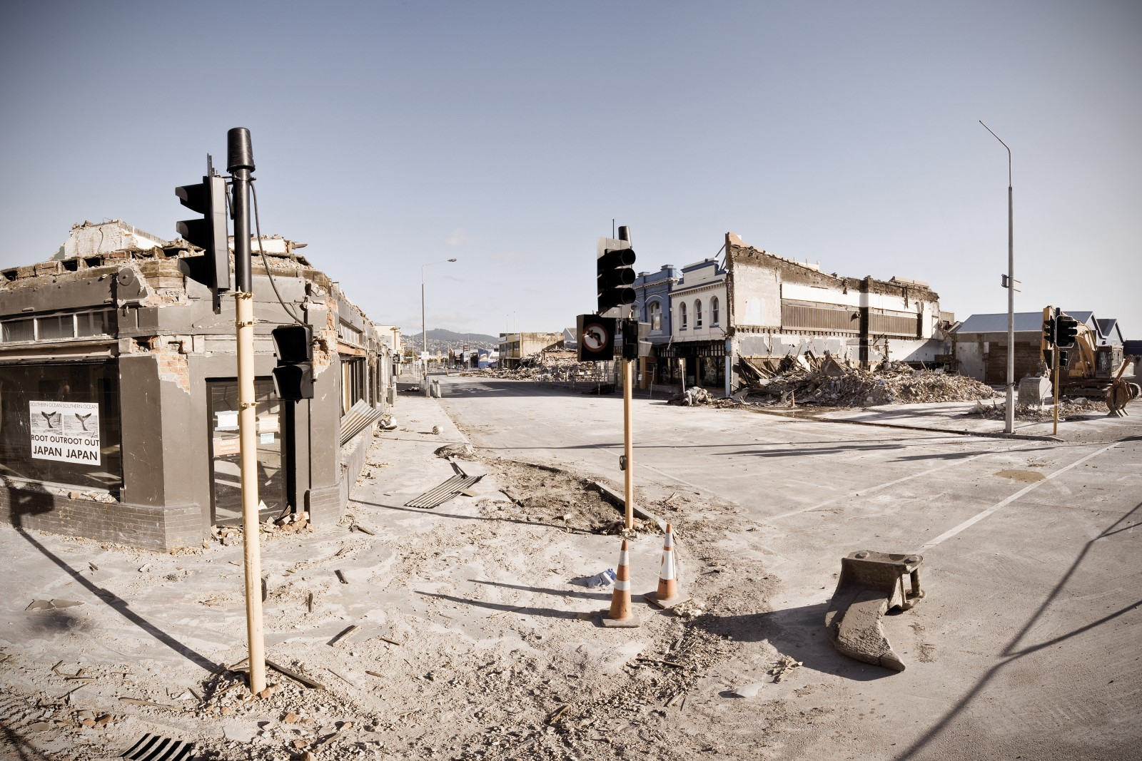 """Evoking a ghost town of the Old West, ruins stand at the intersection of St Asaph and Manchester Sts, just outside the original """"Red Zone"""" cordon sealing the CBD. Beverley Studios, a heritage building once standing on the far corner, was declared safe by an engineer, despite the partial collapse of adjoining buildings in the quake. But in a surprise twist, owners Marg and Peter Straw got word one evening that their building would be demolished the next day. They were given half an hour to remove what they needed. The building was gone by midday."""