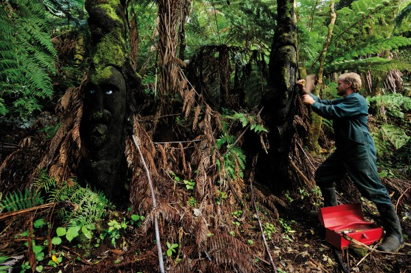 """Lochmara's owner, Shayne Olsen, takes his chisel to one of about 60 """"ponga people"""" scattered around the property. With time on his hands, Olsen began sculpting his living art in the years waiting for resource consents to be granted to develop his lodge, wildlife recovery and art centre."""