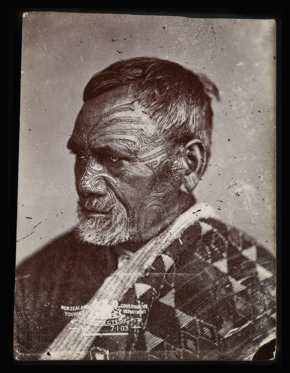 Photographers sometimes accentuated the ta moko (facial tattoo) of their Maori sitters with greasepaint. A few even resorted to retouching prints and, in extreme cases, the negative, though the practice was frowned on and may have been carried out by subsequent owners of the images. McGarrigle appears to have relied on sharp focus and carefully controlled lighting to capture the power of a sitter's ta moko.