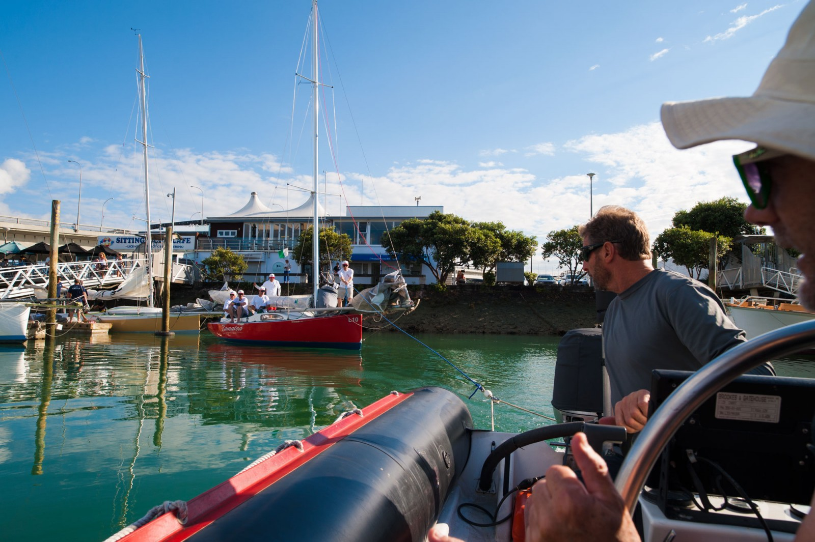 Mullet boats leave their outboards on the dock in a bid to save weight, and instead hoist 700 square feet of sail to the power of the wind. Auspiciously, they were towed out of the dock in front of the Ponsonby Cruising Club, Westhaven, in the order they were to finish in.