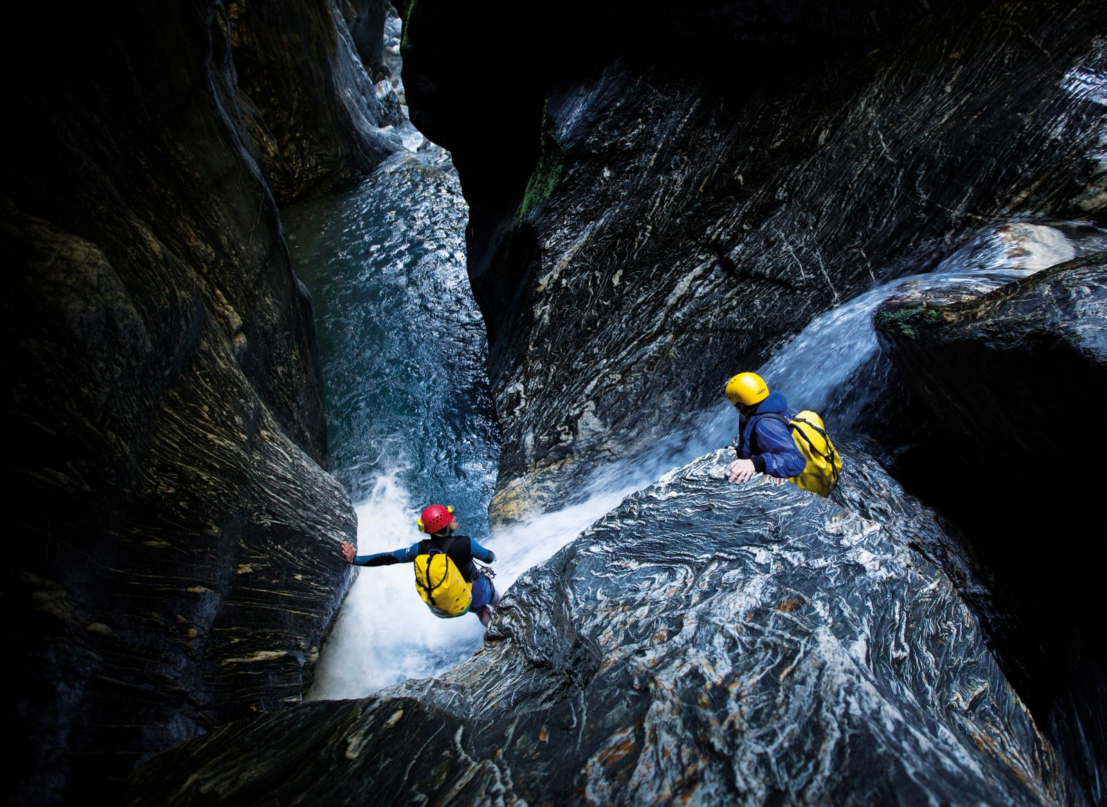 Though canyoning requires individual skills, teamwork is essential. Annette Phillips (below right) contemplates the next phase of the canyon at Wilson Creek with Alain Rohr. The pair have been involved in a new phase of exploration that has opened up dozens of canyons around the country over the past five years and made them more accessible to both local and overseas canyoners. The biggest canyons can take a long time to explore—a team of 10 French canyoners took five days to explore Gloomy Gorge canyon in sections, progressing as little as 100 metres a day in places.