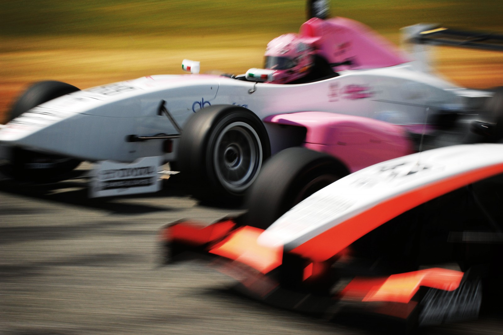 Teretaunga Park Raceway, Invercargill, is one of the most testing tracks on the Toyota Racing Series circuit, mainly due to the weather. But inclement New Zealand conditions are part of the draw for the young drivers in this school of hard knocks. Here driving the pink car, Italy's Michela Cerruti—the only female driver in the 2012 series—battles it out on the home straight with Tanart Sathienthirakul from Thailand.