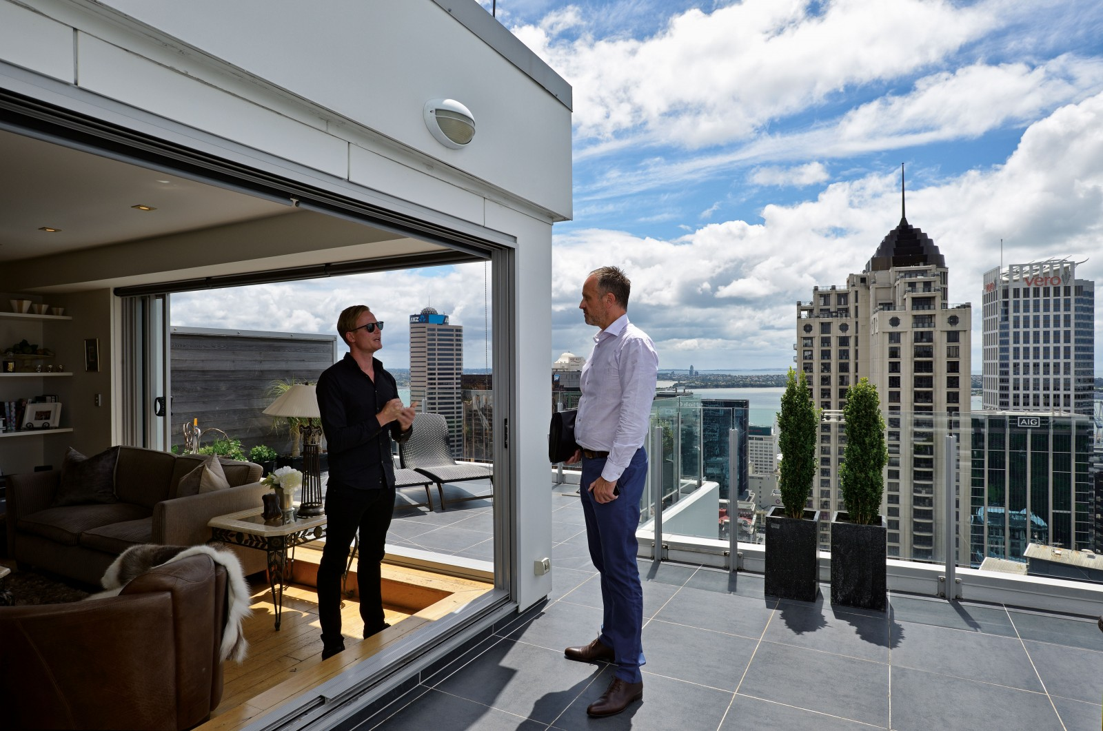 The move of affluent people toward the centre of the city over the past two decades has driven prices exponentially upward in central suburbs, to the benefit of real estate agents such as Blair Haddow, right, selling penthouse properties in Auckland's CBD for millions. It's a worldwide trend that has increased inner city populations 15-fold in two decades and pushed the poor to the periphery. This intensification has brought advantages to some, but also forced families further apart as younger generations can no longer afford to live close to their parents.