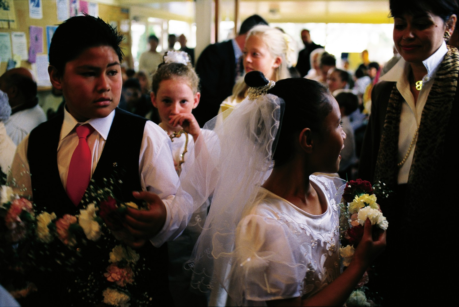 The lives of Catholic children are punctuated by a series of such ceremonies, including first communion (right), where the gorgeous dresses worn by these girls at St Mary's, Papakura, are frequently on display.
