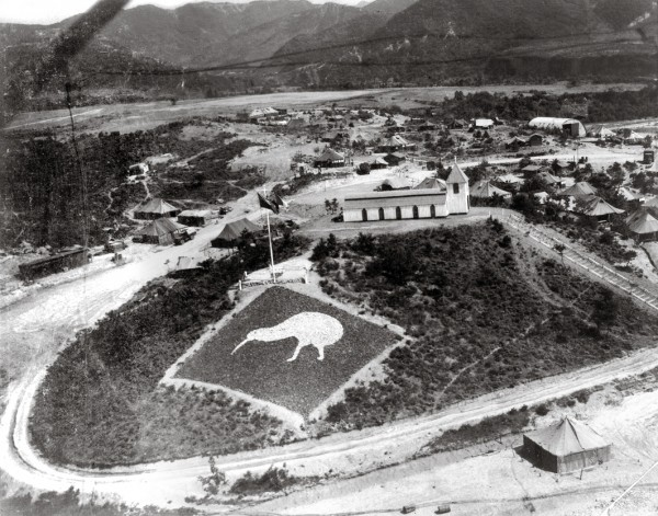 During the three years of the Korean War, the fighting seesawed up and down the peninsula, with the eventual armistice line pretty close to the original border between the two countries, the 38th parallel. The headquarters of 16 NZ Field Regiment was established on what came to be known as Kiwi Hill, about 60 km north of Seoul, close to the demilitarised zone. Beyond the chapel (the large building behind the painted kiwi) lay a cinema and, to the right, the quartermaster's store.