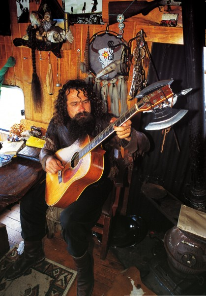 """""""Living in my bus is like living on a magic carpet,"""" says Matt Morris, a one-time bikie and self-confessed """"wild man"""" of the Gypsy Fair. """"It gives me a huge sense of freedom."""" After eight years with the fair, making and selling leather goods (but still finding time to work as an extra in The Lord of the Rings, the inspiration for the axe head that adorns his guitar) Morris has recently cut loose, allowing someone from the waiting list to join the gypsy crew."""