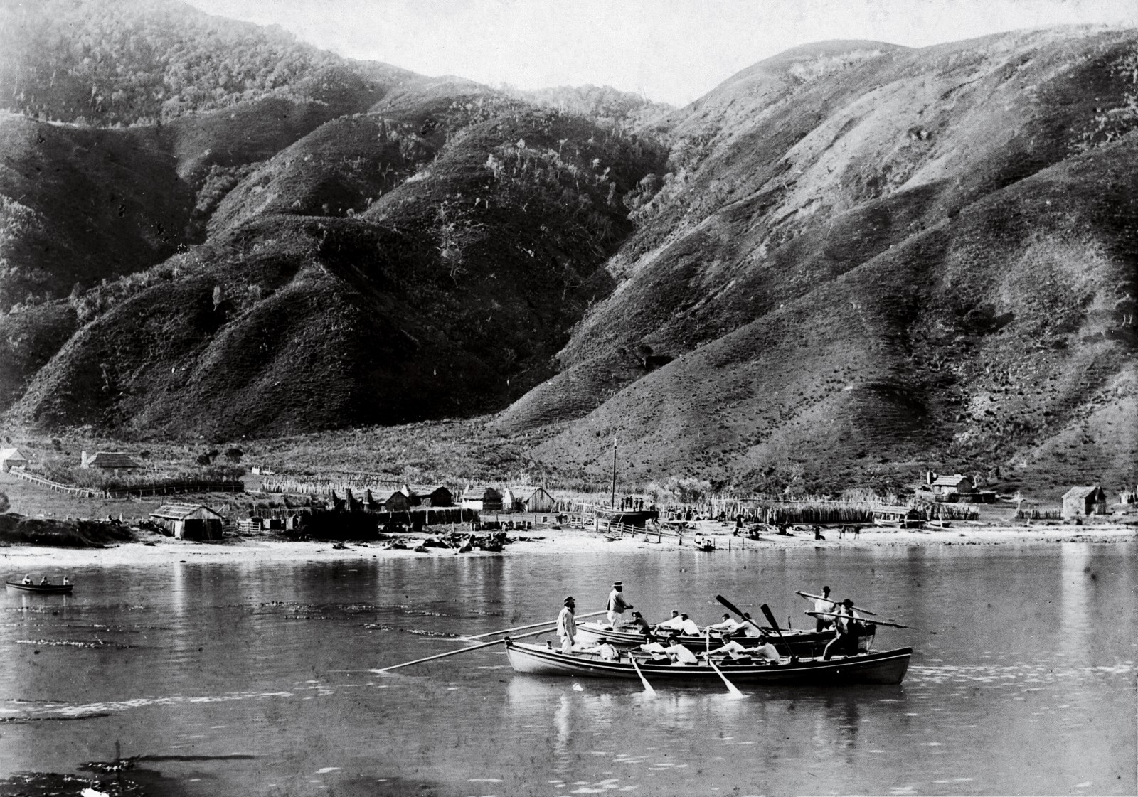 Te Awaiti (known to whalers as Tar'white), inside Tory Channel, was the site of the country's first shore whaling station, set up in the late 1820s by ex-convict Jacky Guard. Whaling was carried out periodically from this bay for almost 100 years, and at the time the Treaty of Waitangi was signed it was the South Island's largest settlement. The dapper dress of the whaleboat crews in this photograph disguises the more gruesome aspects of their trade. After killing their quarry—often a brutal, protracted process—they sewed the mouth shut to reduce water resistance as they towed the carcass back to shore.
