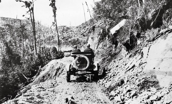 "In 1912 Wellington journalist Arthur Chorlton became the first person to drive to Auckland from Wellington through the forbidding King Country. His vehicle was the popular Model T Ford, or ""Tin Lizzie."" At the time, no real road existed between Taihape and Te Kuiti, although there were local cart tracks and the remains of a service road used in the building of the main trunk railway. Slips and knee-deep mud drew out the journey between Taihape and Aria to a spirit-crushing six-and-a-half days."