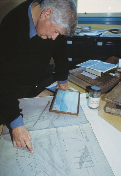 David Stapleton, manager of the Port of Greymouth, studies an 1874 plan of proposed improvements at the mouth of the Grey. The work— building a harbour and putting in protective structures—was carried out between 1885 and 1890 at a cost of $100 million in today's terms. Rough sea conditions on the West Coast mean that the bar is very short, steep and shallow— approximately three metres deep at low water. Periodically, deep- draught vessels, such as some tugs used for towing barges, have to wait for a high spring tide to ensure the necessary one-metre minimum clearance between their keels and the crest of the bar.