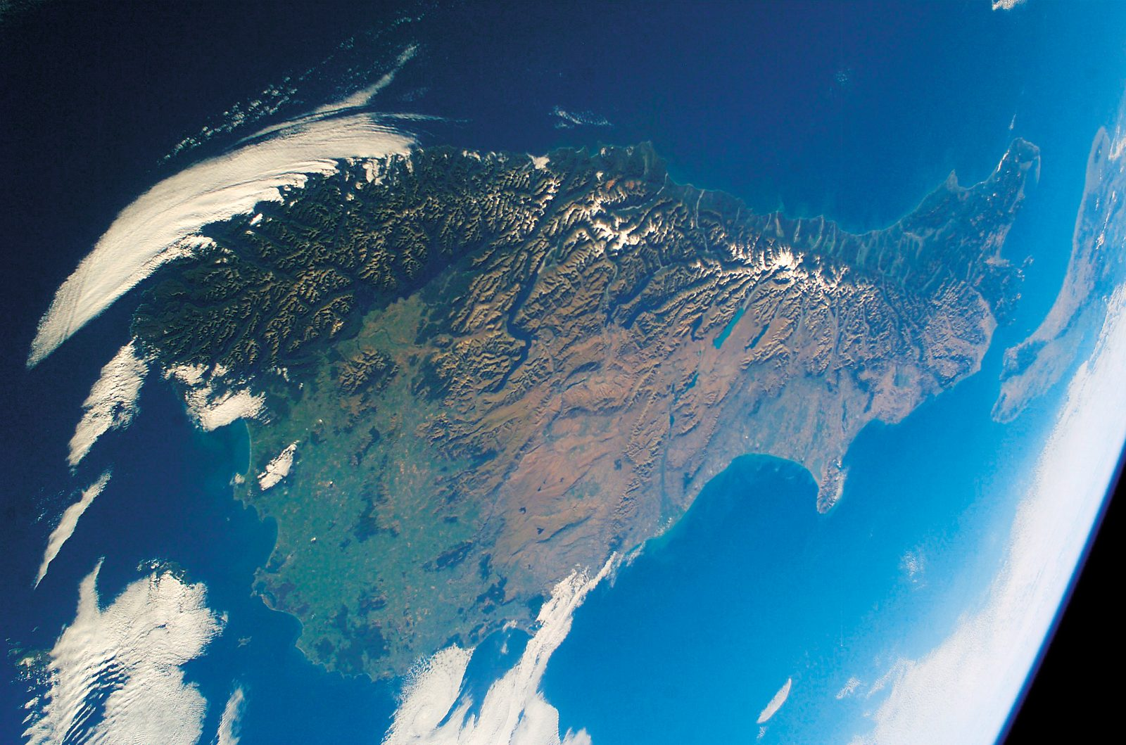 The mountains of the South Island impart some sense of thickness to the land.
