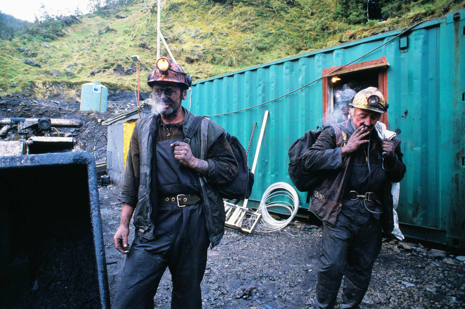Top priority for many miners at the end of a shift in Roa mine, near Blackball, is to light up a cigarette—the first in eight hours. Smoking is forbidden underground because of the presence of methane. West Coast hills have been mined for more than 100 years, but prices for the area's ultra-low-ash bituminous coal have never been higher. All Roa's production is exported for activated carbon and silicon-metal manufacture.
