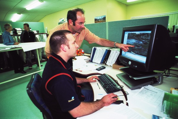 Today's coalmines are modelled on computers long before they become reality. At Solid Energy's Huntly offices, Dean Fergusson (standing) and Andrew Prentice discuss a new section of Rotowaro's opencast operation.