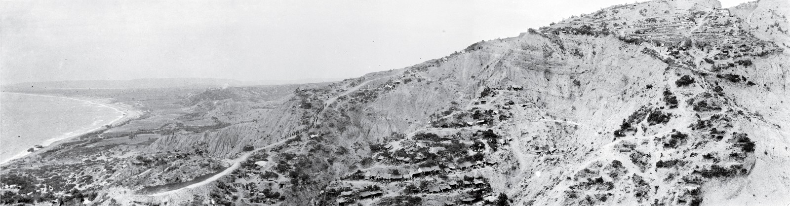 The razorback spur known as Walker's Ridge, on the northern flank of the Anzac line, provided access to the top of First Ridge close to The Nek. Through Herculean efforts with pick and shovel, notably by Colonel Malone's Wellington Battalion, a foot road was constructed up its steep slope, and its deeply eroded sides were terraced to make room for dug-outs.