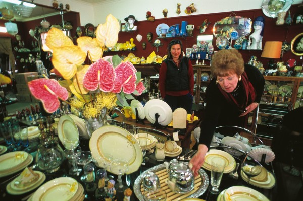Edna McAtamney, the driving force behind Ranfurly's art-deco renaissance, shows a customer some of the treasures in her art-deco emporium, Decollectable.