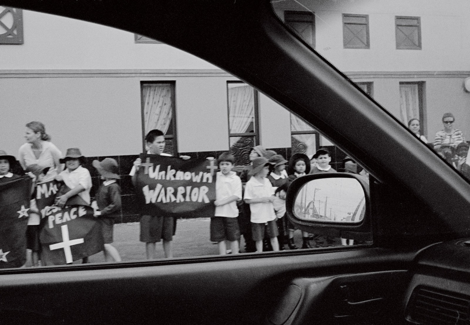 As the cortege travelled from Rongotai to Parliament, many people, including schoolchildren, lined the streets along the route. The Warrior was driven by hearse, with an escort of military and police vehicles. A veteran of El Alamein, Alan Johnston, talks emotionally of his thoughts at the moment he saw the Unknown Warrior appear.