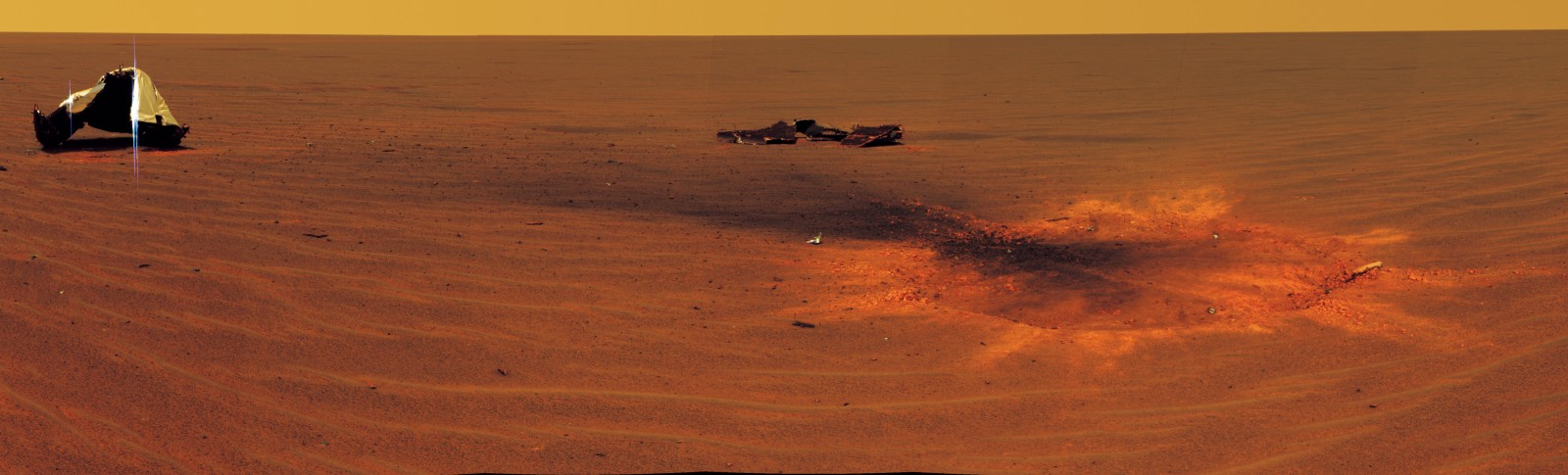 An extraterrestrials that land on Mars will be in no doubt that they have encountered signs of alien intelligence. This picture is taken by the Rover Opportunity as it circles some detritus, including a heat shielf beside an impact-crater of its own landing on Mars. Opportunity also encountered rocks formed out of sulphate salts, confirming that salt-laden seas were once a feature of this apparent wasteland.