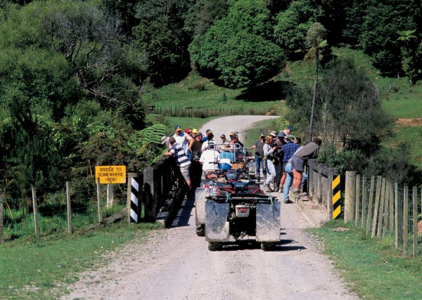 "During a quad-bike outing to remote Aotuhia Station via the old Whangamomona Road, Ravensdown Fertiliser employees pause at the ""Bridge to Somewhere"", the twin of the famous ""Bridge to Nowhere"" in Whanganui National Park. Both structures recall failed attempts to establish viable dairy farms in these remote, hilly regions. Quad bikes are a boon to farmers negotiating steep and slushy farm tracks."