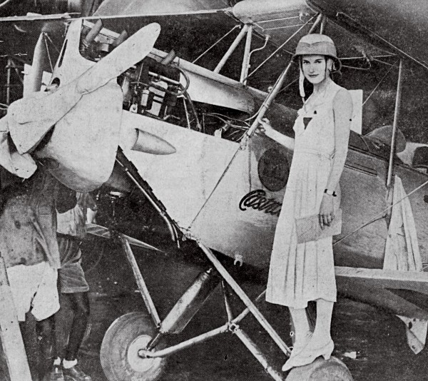 Jean Batten usually managed to look demure in public regardless of the circumstances. While crossing India en route to Calcutta (where this was taken), an oil leak threatened the engine and rubber in her shoes and goggles melted from heat.