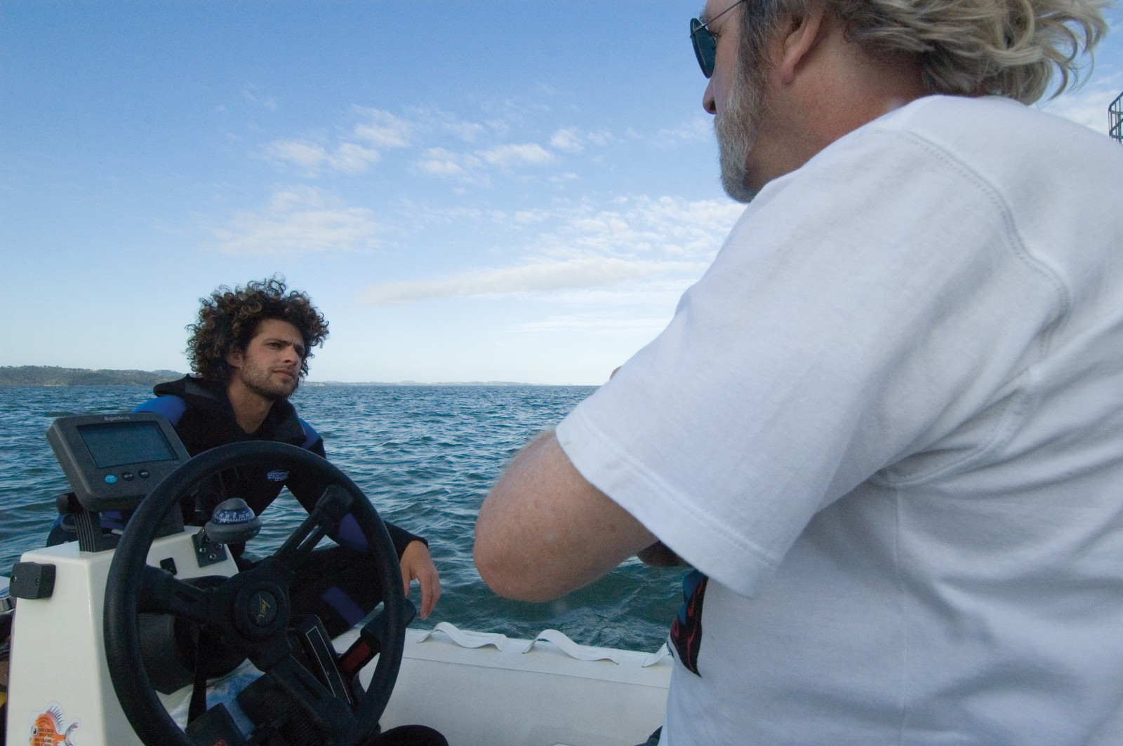 Biologist Michael Richlen and skipper Mike Percy (of the Western Underwater Research Team) wait for the brief window of slack water to retrieve an underwater POD that records the sounds of passing dolphins and whales from near Cornwallis.