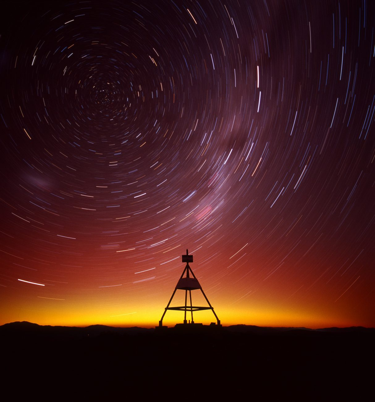 The stellar South Pole in a time-lapse image from Mt John, Canterbury, shows stars tracing arcs across the night sky. A favourable climate and clear views of the Milky Way during winter make Mt John an excellent location for stargazing.