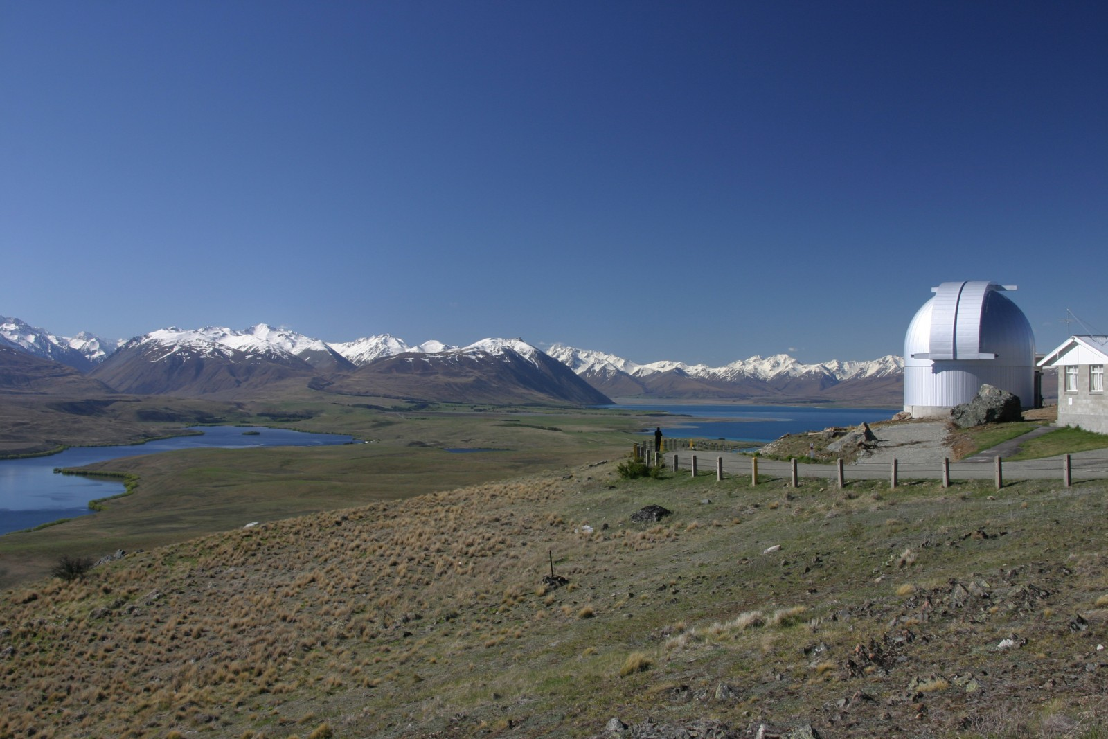 The MOA telescope at Mt John Observatory lies east of the Southern Alps with Lake Alexandrina to the left, and Lake Tekapo to the right (opposite). The telescope was commissioned with a grant from the Japanese government. Built in Japan and assembled in New Zealand in 2004, the telescope utilises a camera with ten CCDs and 80 million pixels to look for dark matter and extrasolar planets.