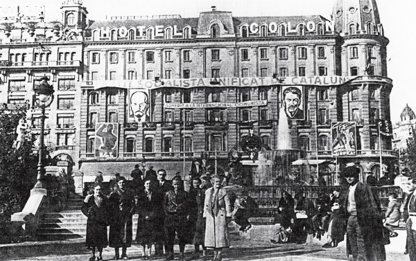 At the time this photo was taken, Barcelona's Hotel Colon had become the headquarters for the Communist Party, embellished with portraits of Stalin and Lenin. It was from here that Dolores Ibárruri broadcast her incendiary speeches in 1936. Posing with this group, New Zealand nurse Una Wilson is wearing a light-coloured coat.