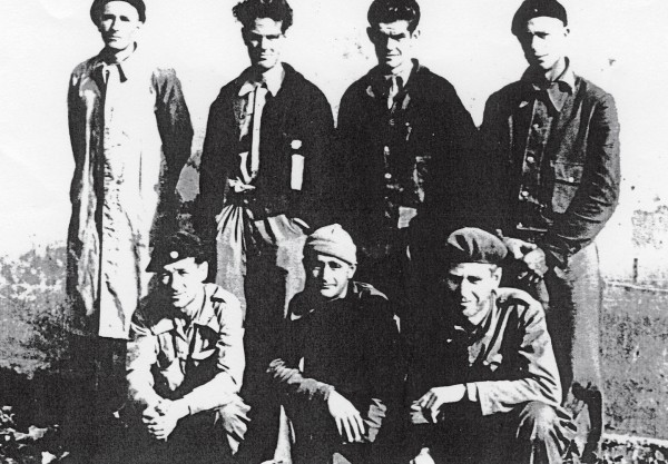 "Waiting to return home from Spain in October 1938 are New Zealanders Bert Bryan (front centre) and William ""Murn"" MacDonald (back, third from left) with Australian International Brigaders."