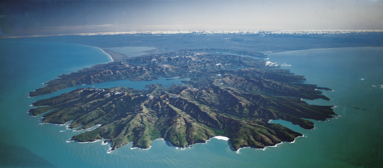 Ancient volcanism lies behind the mountainous terrain of the peninsula and its twin harbours—Akaroa, opening to the south and the more distant Lyttelton opening to the north. Both harbours were once eruptive centres.