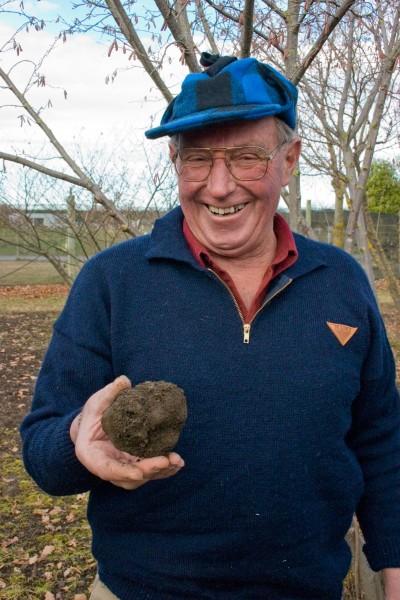 John Burns of Ashburton shows off a sizeable black truffle he has grown.