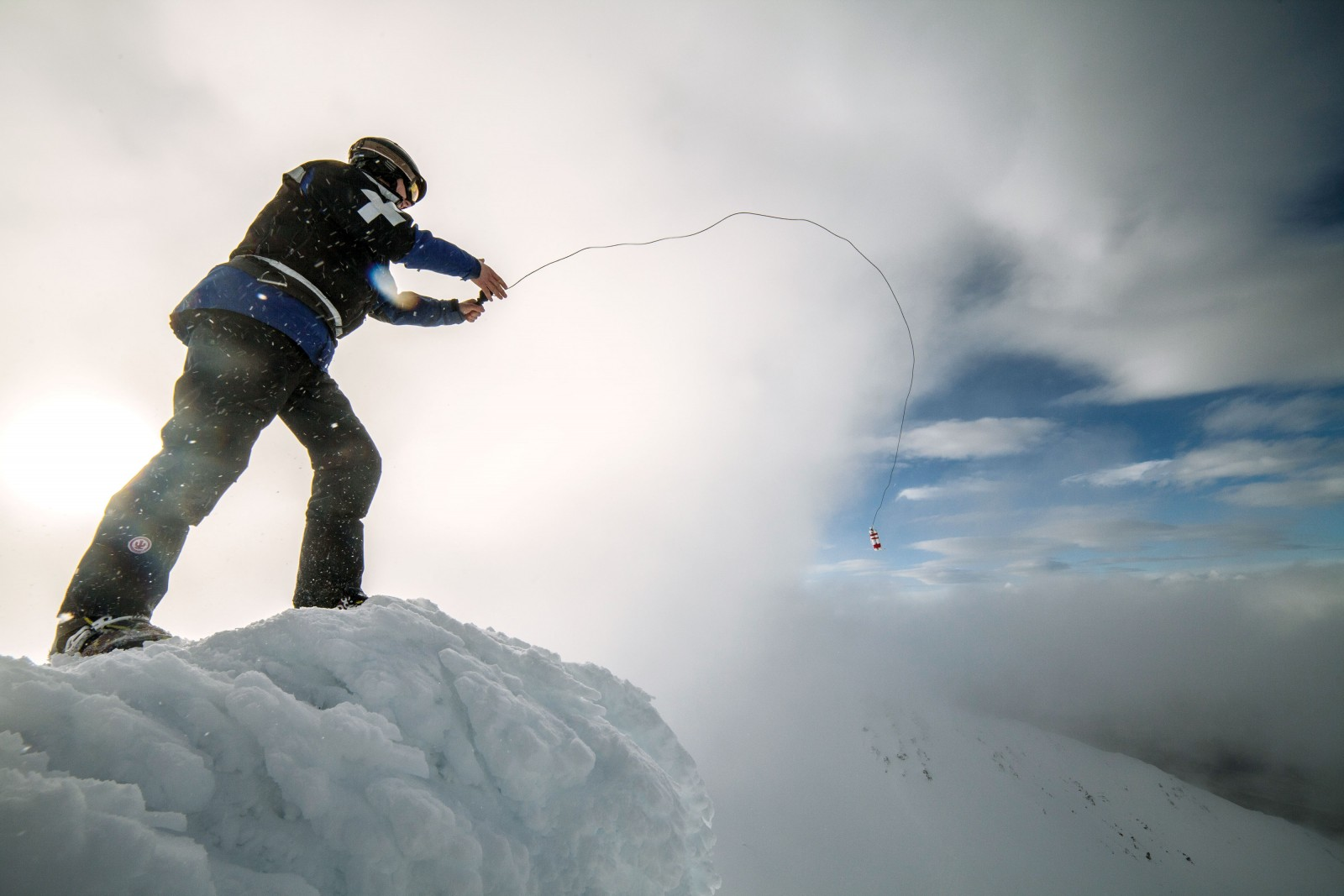 On ski fields, snow safety personnel routinely monitor the accumulation of snow and pre-empt avalanches by setting off controlled slips. This is often done by traversing dangerous faces on skis while belayed on a safety rope, using explosives or even cannons.