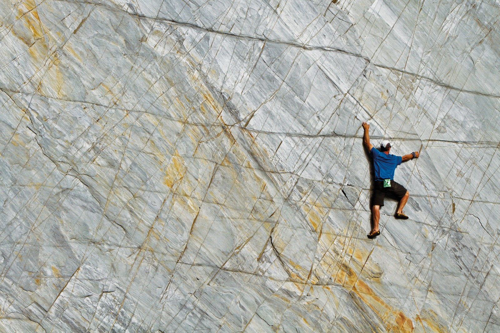 Jamie Vinton-Boot explores a seemingly blank wall of schist on the Eye Tooth slabs at the head of the Otoko Valley. The level of concentration required when climbing without ropes can alter one's mental state. The surrounding environment, and even an appreciation of time, is lost to the minutiae of tasks before the climber. Far from the misconception that climbers are adrenaline junkies, traversing a wall such as this requires precision, concentration and judgment far beyond that employed in everyday life.