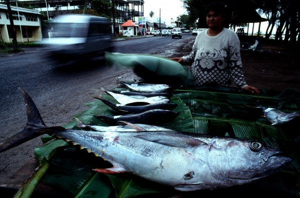 In downtown Avarua a street vendor offers the catch of the day: fresh tuna.