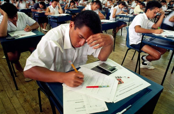 Tou Tavake (foreground) sits an engineering examination at Tereora College, the largest secondary school in Rarotonga.