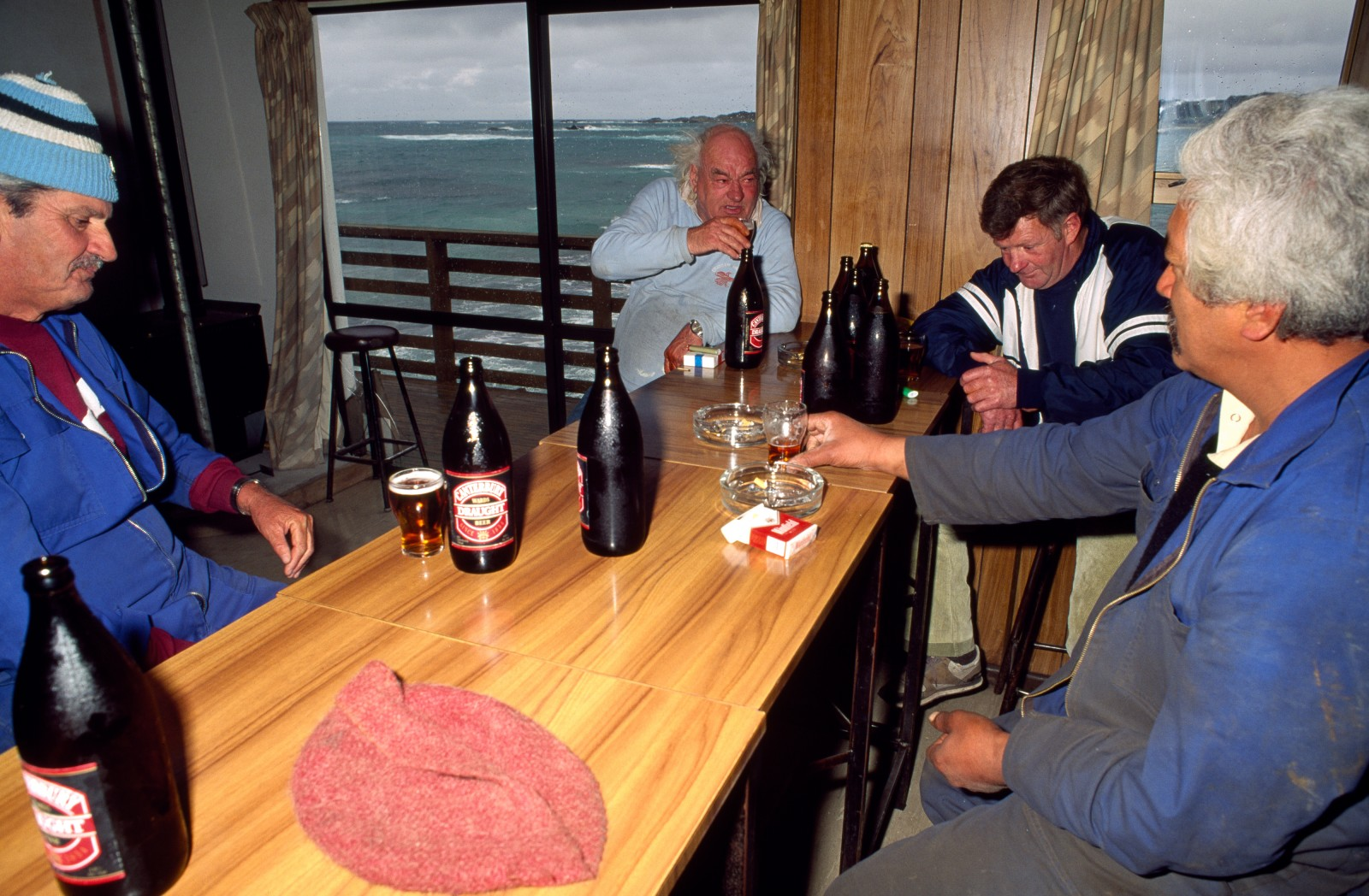 "The locally-brewed Black Robin beer, on tap at the Kaingaroa Sports &' Social Club, makes waiting a social event. Life in Kaingaroa revolves around the club-the small fishing village's community living room. ""We've got the best fishing grounds in the world at one end of our road,"" says a regular, ""and this at the other end. Bliss."""