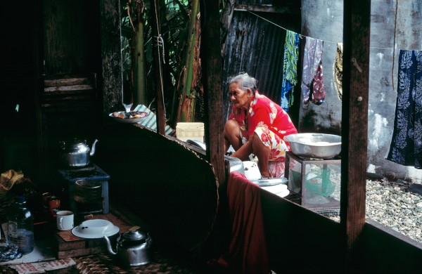 There is no escape from domestic drudgery for the women of Tokelau. Unlike men, who fish for tuna on the high seas and travel across the lagoon to collect nuts and tend gardens, women lead virtually their entire lives within the confines of the village. Ivoga Tufala is lucky: her kitchen is equipped with a kerosene burner. Most women cook over an open fire.