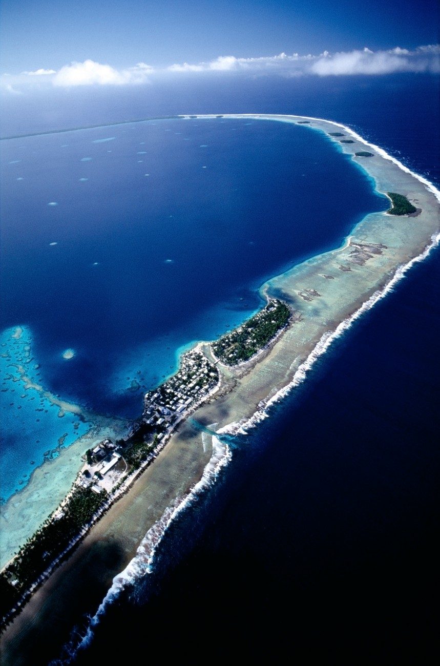 Nukunonu, like Tokelau's two other atolls, consists of a ribbon of coral rock anchored to the rim of a buge undersea volcano. The volcano's crater is the lagoon; beyond lies the wild ocean. Together, the atolls boast a total land area of just 12 square kilometres. But the 1600 inhabitants are squeezed into an area much smaller than that: on each atoll, only one main island is occupied.