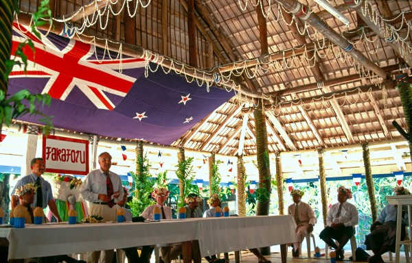 United Nations delegation addresses the elders of Fakaofo in the village's ornate meeting house, encouraging them to continue the decolonisation process. Islanders are ambivalent about independence; they want a greater say in their own affairs, but also want to retain New Zealand's annual aid package, which equates to around $2500 per person. The link with New Zealand goes beyond monetary assistance. Many of Tokelau's children leave their homes for a scholarship-funded education in New Zealand. Well-educated young people are regarded as Tokelau's best hope for making a successful transition from subsistence society to modern Pacific state.