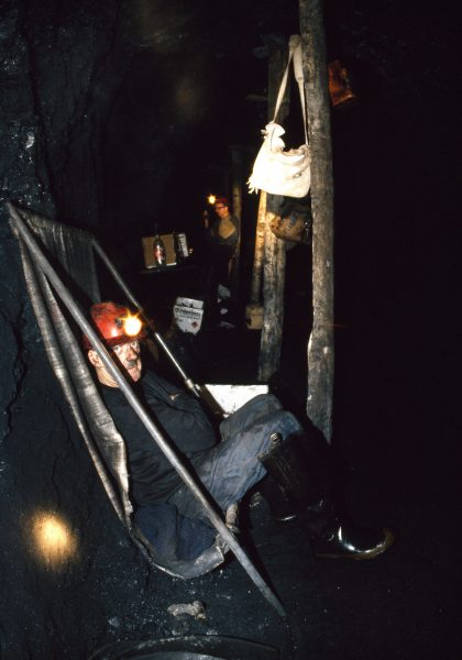 "Deep in the Sullivan mine near Denniston, Ollie takes his smoko or ""crib"" in a make-shift sling. Most miners spend their entire 7 - 12-hour shifts below ground, because the surface is too far off."