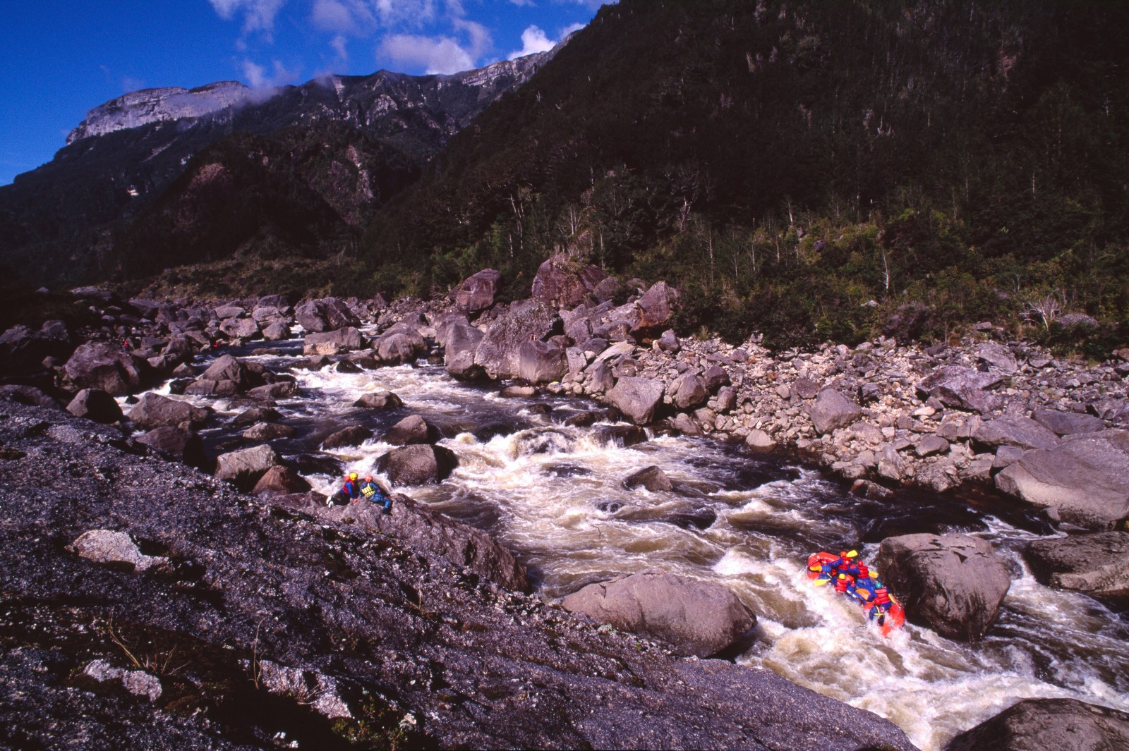 Boulders shaken from the ramparts of Garibald Ridge by the 1929 Murchison earthquake keep adrenalin flowing faster tan water for rafters braving the wild Karamea River.