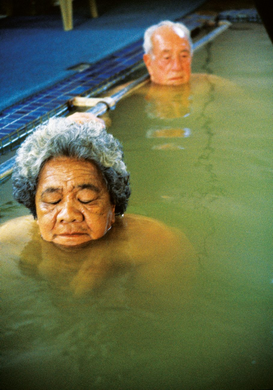 Te Puia's mineral waters have long been said to possess curative powers, and when the Coast road first opened in the 1920s motor services brought travellers to the spa from far afield. Today Te Puia Hospital provides the district's elderly—among them Whata Sadlier and Fred Malcolm—with a ride and a soak in its indoor pool.