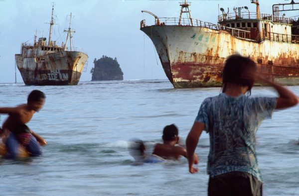 Children play amid rusting monuments to the vigour of cyclone Val, which in 1991 grounded many large tuna boats in Pago Pago Harbour, American Samoa.