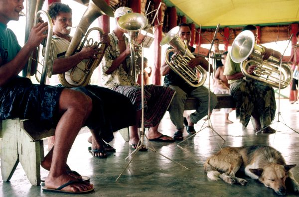 Practice time for the Salologa village brass band. Perhaps a legacy of the years of German colonial rule, brass bands remain popular in Samoa. So does dance music. To the beat of an impromptu jam session in a Savai'i hotel, the owner boogies with a burly patron.