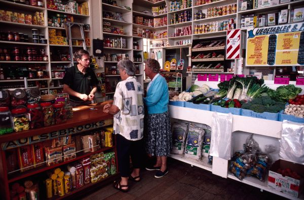 Preserving a retail style which has long disappeared from urban New Zealand, Des White, manager of H. Hodgson & Co, general merchants, of Murchison, serves customers from elderly shelves stocked with a huge array of wares. The business has served the town and surrounding district (population 750) since early this century. However, newly introduced health regulations will rob the store of some of its ambience: the wooden floorboards must be covered with linoleum or tiles.